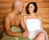 Busty brunette Brooke Lee Adams fucks in a sauna
